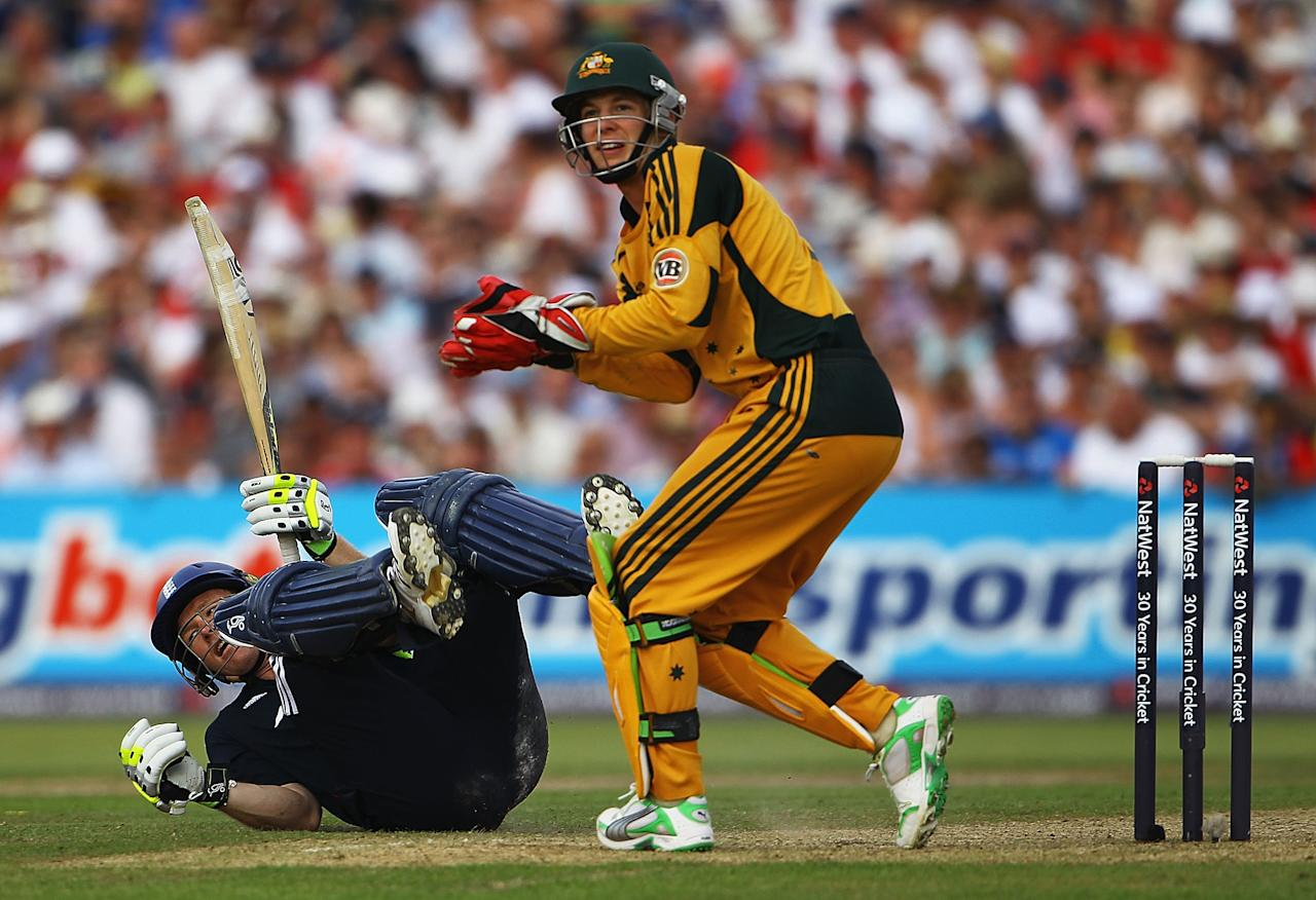 MANCHESTER, ENGLAND - JUNE 27:  Eoin Morgan of England watches his reverse sweep shot go to the boundary, as Tim Paine of Australia looks on during the 3rd NatWest One Day International between England and Australia at Old Trafford on June 27, 2010 in Manchester, England.  (Photo by Matthew Lewis/Getty Images)