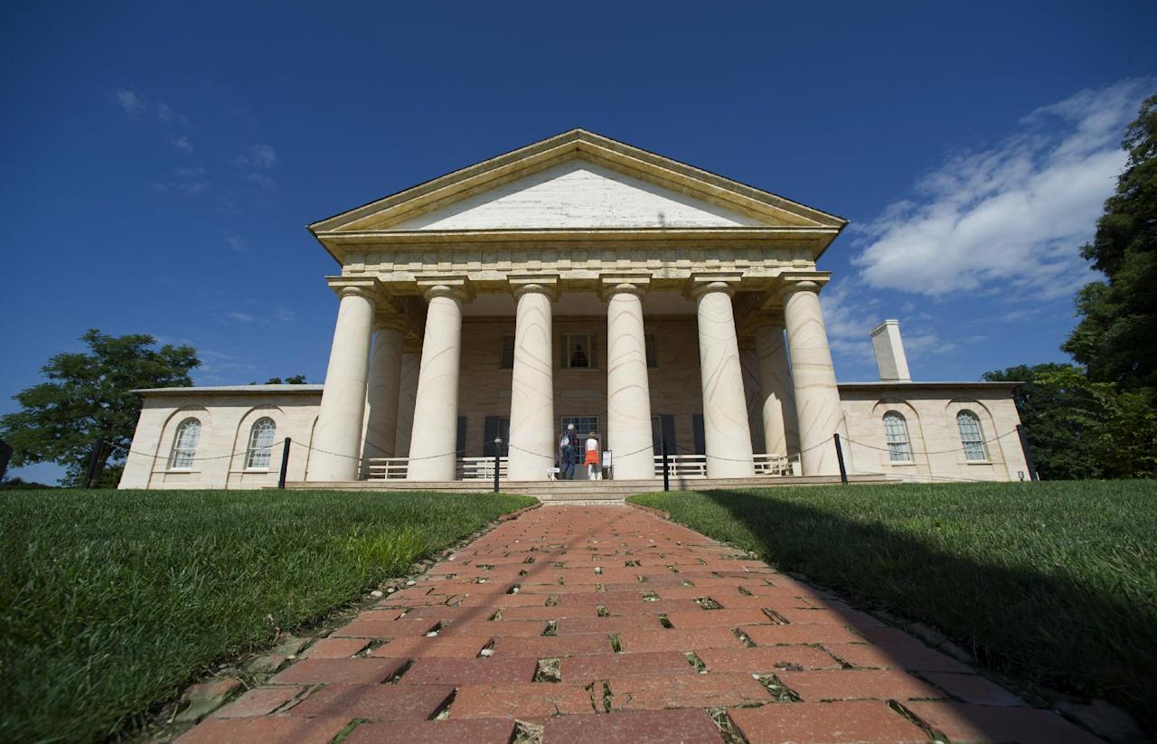The historic Arlington House mansion is seen at Arlington National Cemetery in Arlington, Va., Thursday, July 17, 2014. The historic house and plantation originally built as a monument to George Washington overlooking the nation's capital that later was home to Confederate Gen. Robert E. Lee and 63 slaves will be restored to its historical appearance after a $12.3 million gift from Philanthropist David Rubenstein. (AP Photo/Cliff Owen)