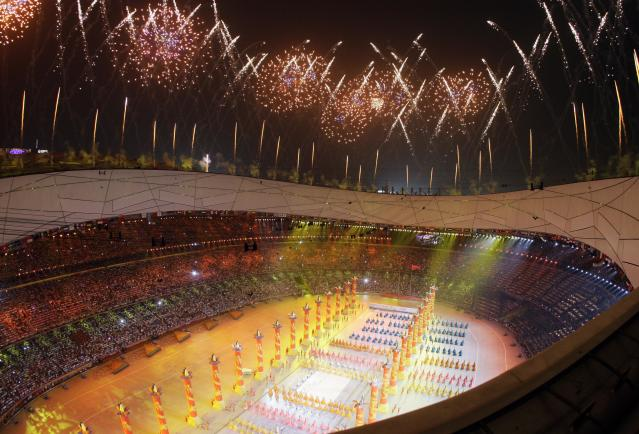 Fireworks explode over the National Stadium during the opening ceremony for the Beijing 2008 Olympics in Beijing, Friday, Aug. 8, 2008. (AP Photo/Julie Jacobson)
