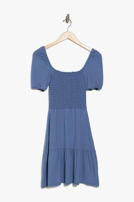 Her outfit has been identified as a £21 blue smocked dress from brand Velvet Torch. (Nordstrom)