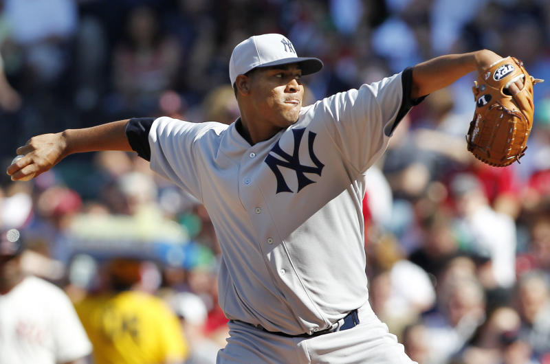 New York Yankees' Ivan Nova pitches in the first inning of a baseball game against the Boston Red Sox at Fenway Park in Boston, Friday, April 20, 2012. To celebrate the 100th birthday of Fenway Park, players wore uniforms replicating the ones worn in 1912. (AP Photo/Michael Dwyer)
