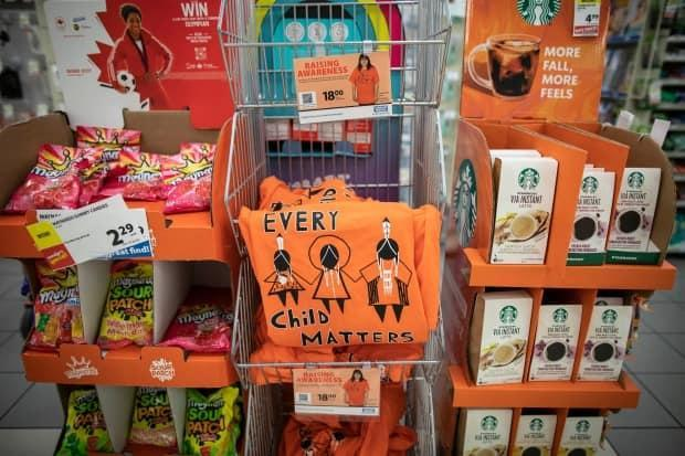 Orange shirts with the description 'Every Child Matters' is pictured for sale at a London Drugs store in Vancouver, B.C. on Tuesday, Sept. 28, 2021.  (Ben Nelms/CBC - image credit)