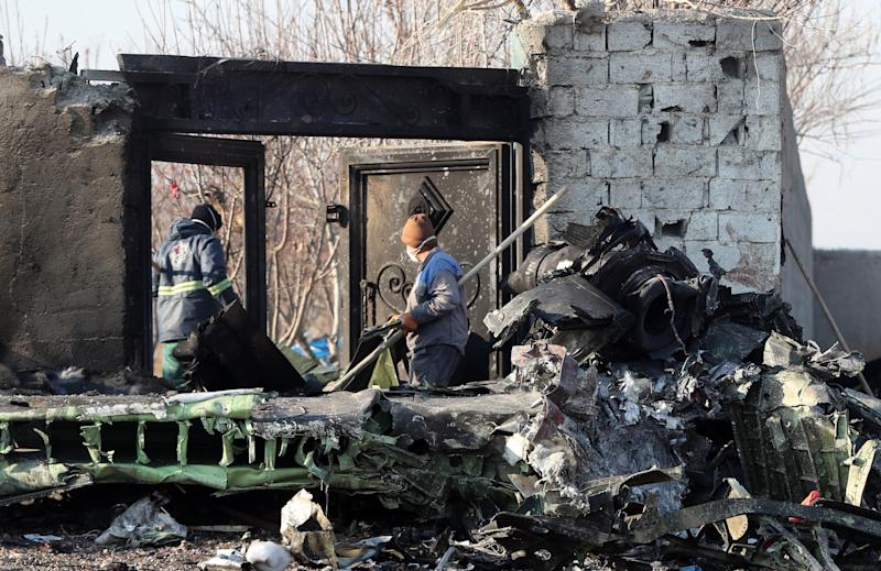 Rescue teams work amidst debris after a Ukrainian plane carrying 176 passengers crashed near Imam Khomeini airport in the Iranian capital Tehran early in the morning on January 8, 2020, killing everyone on board. (Photo: AFP via Getty Images)