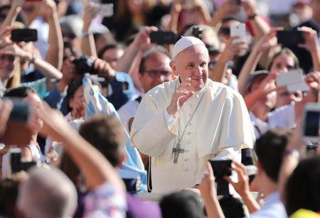FILE PHOTO: Pope Francis waves as he arrives to lead the Wednesday general audience in Saint Peter's square at the Vatican, September 12, 2018. REUTERS/Tony Gentile/File Photo
