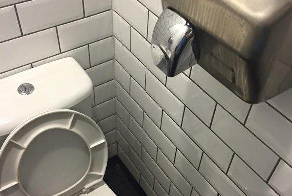 The hand dryer, next to the loo.