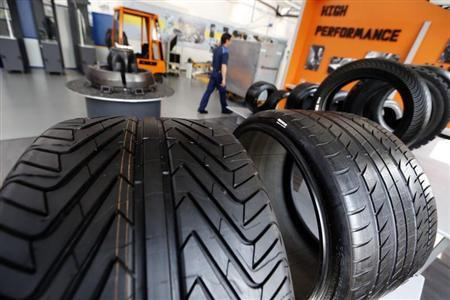 Various Michelin tyres are displayed at the entrance of the Michelin tyre company's factory in Clermont-Ferrand, central France, July 10, 2013. REUTERS/Regis Duvignau