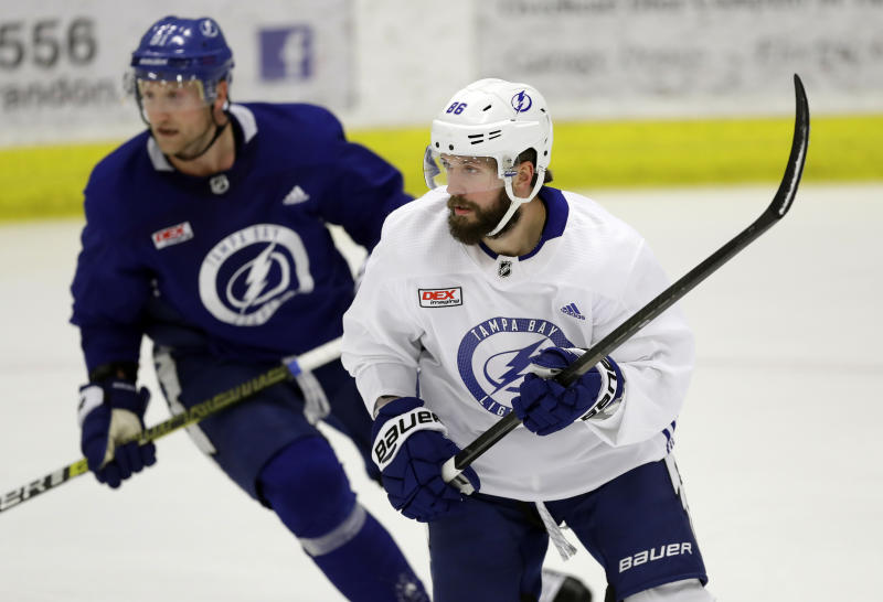 Tampa Bay Lightning right wing Nikita Kucherov, right, looks for a pass in front of center Steven Stamkos during the first day of training camp Friday, Sept. 13, 2019, in Brandon, Fla. (AP Photo/Chris O'Meara)