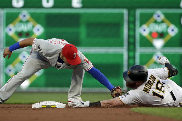 Philadelphia Phillies second baseman Cesar Hernandez, left, puts a tag on Pittsburgh Pirates' Colin Moran who singled off Phillies starting pitcher Jake Arrieta and was out advancing on the throw during the fourth inning of a baseball game in Pittsburgh, Friday, July 19, 2019. (AP Photo/Gene J. Puskar)