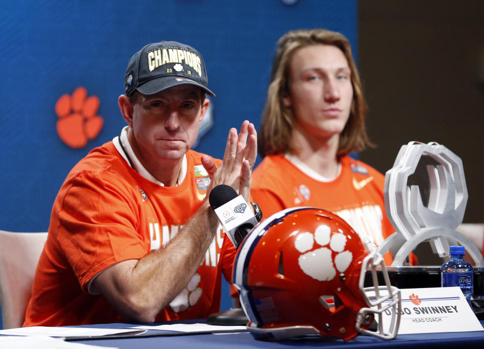 Clemson head coach Dabo Swinney and quarterback Trevor Lawrence, right, responds to questions during a news conference after their NCAA Cotton Bowl semi-final playoff football game against Notre Dame on Saturday, Dec. 29, 2018, in Arlington, Texas. Clemson won 30-3. (AP Photo/Michael Ainsworth)