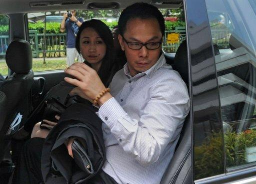Former Singapore's Central Narcotics Bureau head Ng Boon Gay (R) and his wife leave the subordinate court