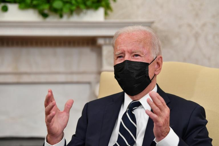 """US President Joe Biden said China """"continues to reject calls for transparency and withhold information, even as the toll of this pandemic continues to rise"""" (AFP/Nicholas Kamm)"""