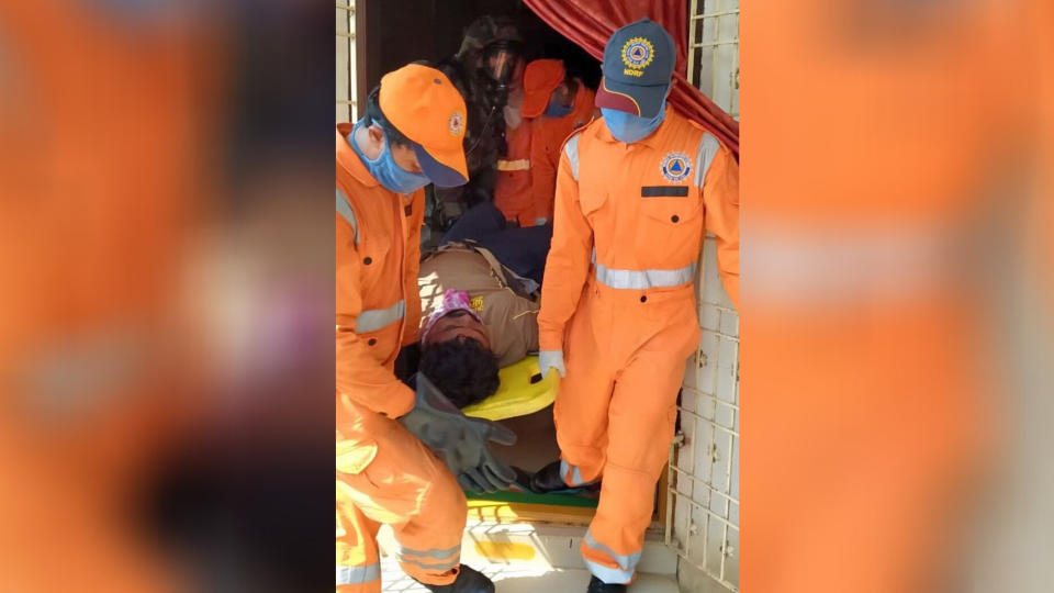 NDRF personnel evacuate an unconscious man after a major chemical gas leakage at LG Polymers industry in RR Venkatapuram village.