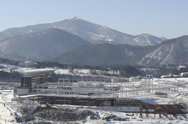 <p>This Friday, Feb. 3, 2017 photo shows the Olympic Plaza, the venue for the opening and closing ceremonies of the 2018 PyeongChang Winter Olympics, under construction in Pyeongchang, South Korea. One year before the Olympics, the country is in political disarray, and winter sports are the last thing on many people's minds. To say that South Koreans are distracted from what had been billed as a crowning sports achievement is an understatement. (AP Photo/Lee Jin-man) </p>