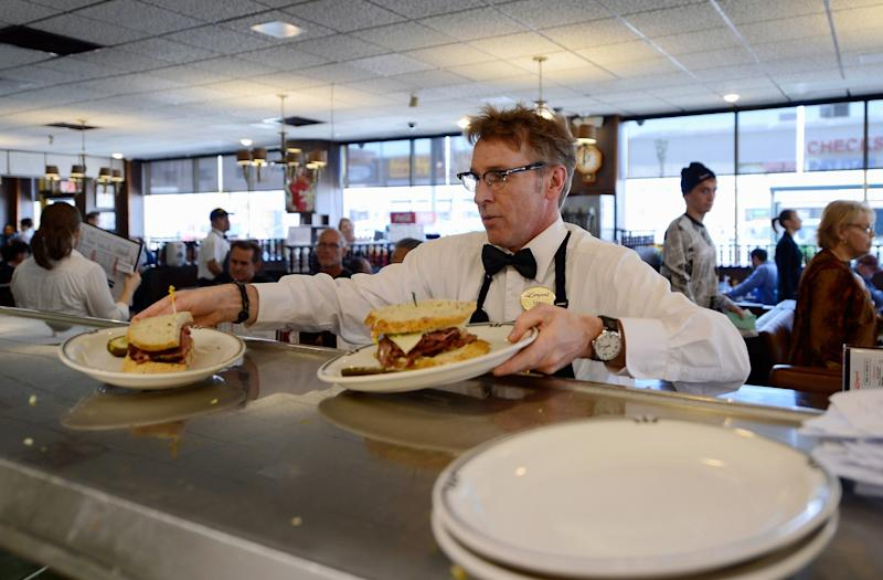 Waiter Dan Smith serves Langer's Delicatessen famous #19 pastrami sandwiches on February 26, 2013 in Los Angeles, California. (Getty)