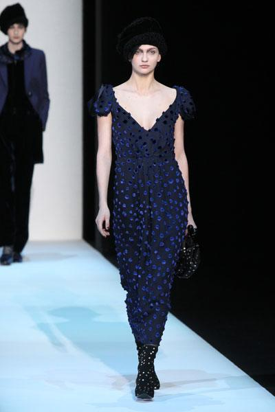 <b>Milan Fashion Week AW13: Giorgio Armani </b><br><br>V-neck dresses were adorned with a dotty print and teamed with black accessories.<br><br>© Getty