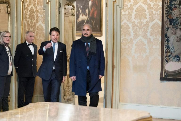 Italy's Prime Minister Giuseppe Conte (3rdL) welcomes Libya's military strongman Khalifa Haftar (R) for talks in Rome (AFP Photo/Handout)