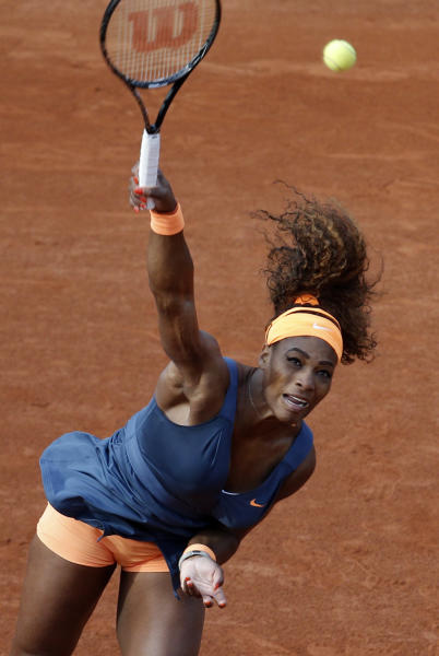 Serena Williams, of the U.S, serves the ball to France's Caroline Garcia during their second round match of the French Open tennis tournament at the Roland Garros stadium Wednesday, May 29, 2013 in Paris. (AP Photo/Christophe Ena)