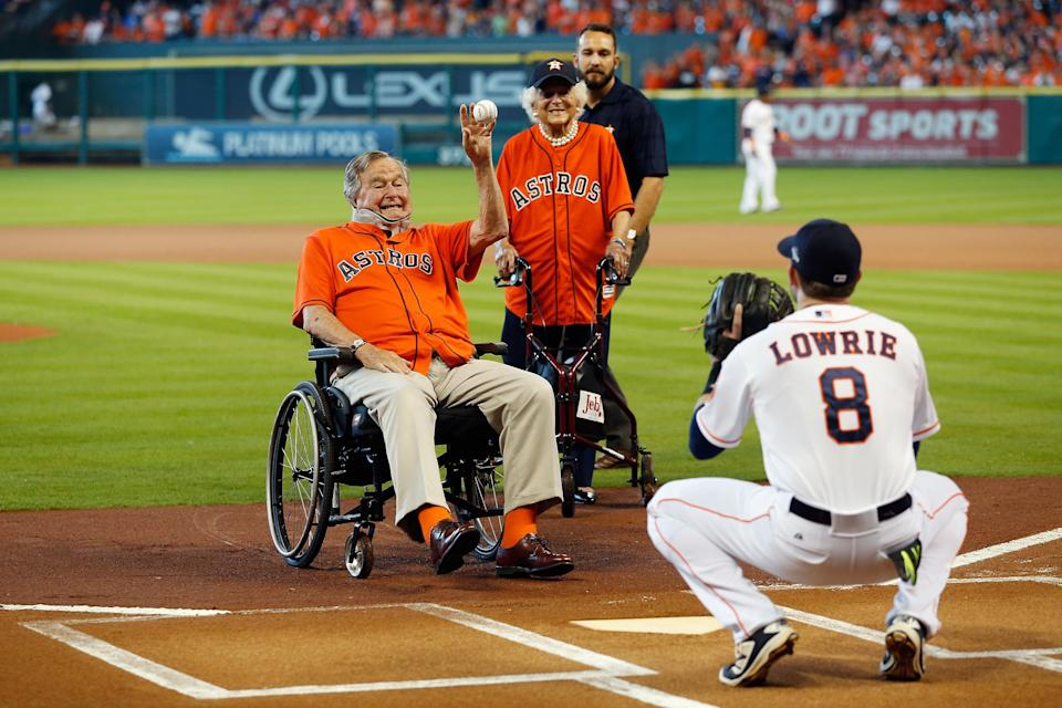 George H.W. Bush throws out the ceremonial first pitch to Jed Lowrie of the Houston Astros, as Barbara Bush looks on, prior to game three of the American League Division Series between the Astros and the Kansas City Royals at Minute Maid Park on Oct. 11, 2015, in Houston.