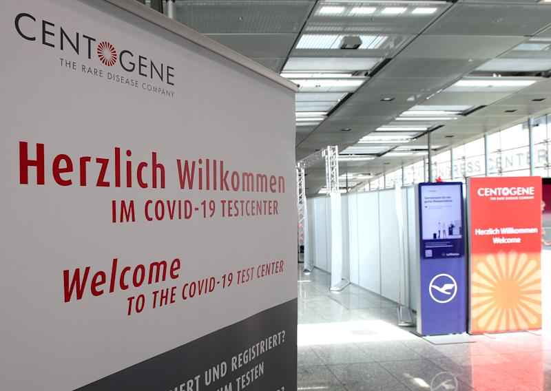 "A picture taken on June 30, 2020 at the airport in Frankfurt am Main shows a sign at the entrance of a walk-in testing centre for the new coronavirus opened by German biotech company Centogene. - Frankfurt airport opened a walk-in testing centre on June 29, 2020 where passengers can pay to take a coronavirus test and get their results within hours, in a bid to reassure anxious travellers as the summer holidays kick off. Passengers will be notified of the result via a ""secure digital platform"" and the information can be connected to a boarding pass for those flying to countries requiring a negative test before entering, German biotech Centogene said in a statement. (Photo by Daniel ROLAND / AFP) (Photo by DANIEL ROLAND/AFP via Getty Images)"