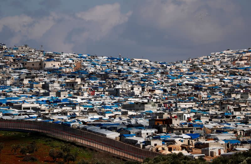 FILE PHOTO: The Atma IDP camp, located in Idlib Governorate of Syria and housing internally displaced Syrians, is pictured from a Turkish border village in Hatay province