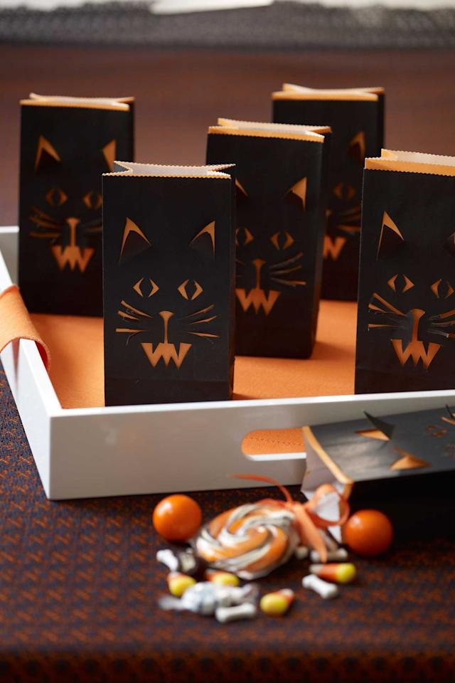 "<p>Lunch just got a lot spookier with these cat face bags. Make them with the kids on Sunday afternoon, then pack their lunches in them the next day.</p><p><strong><a rel=""nofollow"" href=""https://www.womansday.com/home/crafts-projects/how-to/a5875/halloween-craft-how-to-cat-face-treat-bags-123825/"">Get the tutorial. </a></strong></p><p><strong>Tools you'll need:  </strong>tracing paper ($6, <a rel=""nofollow"" href=""https://www.amazon.com/Artists-Tracing-Sheets-Translucent-Sketching-Lightweight/dp/B076VS244N/"">amazon.com</a>), orange and black treat bags ($4, <a rel=""nofollow"" href=""https://www.amazon.com/Party-Friendly-Pieces-Orange-Amscan/dp/B00TOGIOMC/"">amazon.com</a>)</p>"