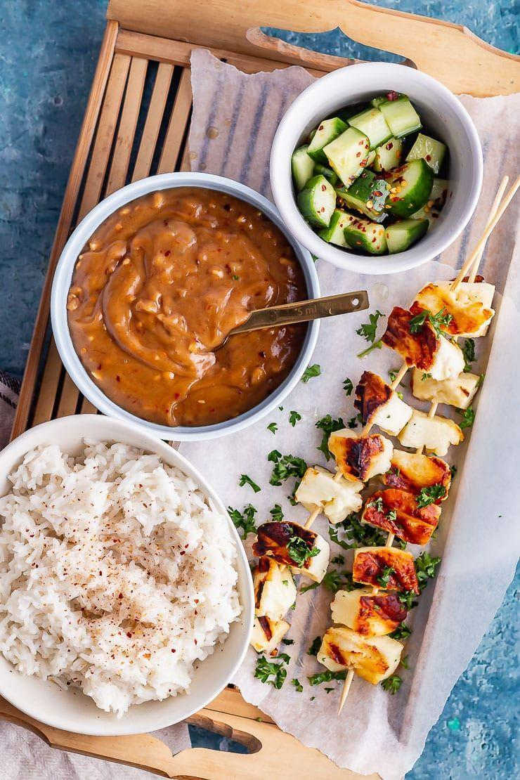 """<p>These delicious halloumi skewers are the light and healthy summer dinner that you're craving. And that cucumber salad? Incredible. </p><p>Get the <a href=""""https://thecookreport.co.uk/grilled-halloumi-skewers/"""" rel=""""nofollow noopener"""" target=""""_blank"""" data-ylk=""""slk:Grilled Halloumi Skewers with Satay Sauce"""" class=""""link rapid-noclick-resp"""">Grilled Halloumi Skewers with Satay Sauce</a> recipe.</p><p>Recipe from <a href=""""https://thecookreport.co.uk/"""" rel=""""nofollow noopener"""" target=""""_blank"""" data-ylk=""""slk:The Cook Report"""" class=""""link rapid-noclick-resp"""">The Cook Report</a>.</p>"""