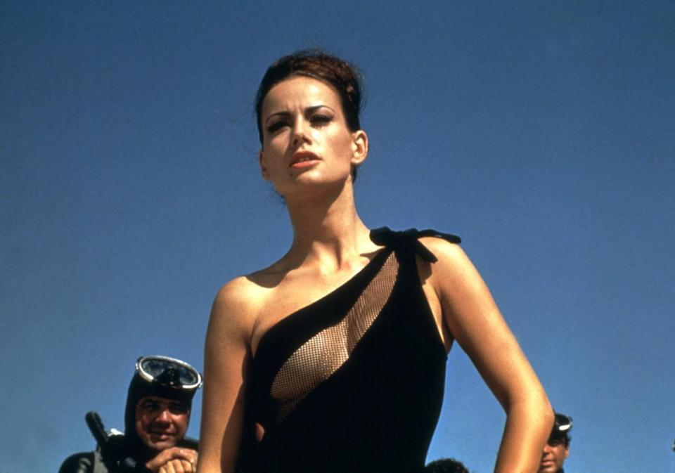 <p>Often dressed in black and white to hammer home her nickname, Domino is the mistress of Spectre's Number Two, Emilio Largo. She helps Bond infiltrate an underwater bunker and looks killer in her swimwear and scuba gear paired with mod cat-eye liner. <i>(Photo: Everett Collection)</i></p>