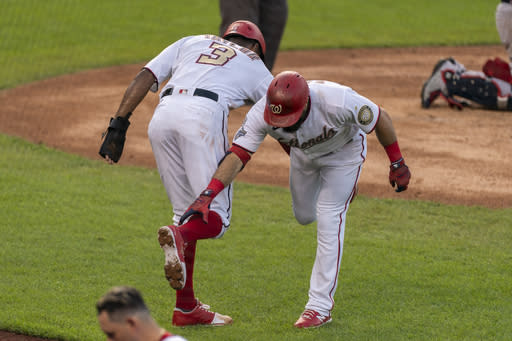 Washington Nationals' Adam Eaton is congratulated by teammate Michael A. Taylor (3) after hitting a two-run home run during the second inning of a baseball game in Washington, Thursday, Sept. 10, 2020. (AP Photo/Manuel Balce Ceneta)