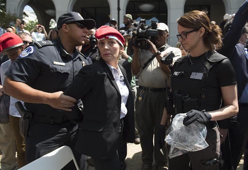 """Police arrest a woman after she handed out free marijuana joints to DC residents on Capitol Hill as part of the 1st Annual Joint Session to mark """"4/20"""" day and promote legalizing marijuana on Capitol Hill in Washington, DC, April 20, 2017"""