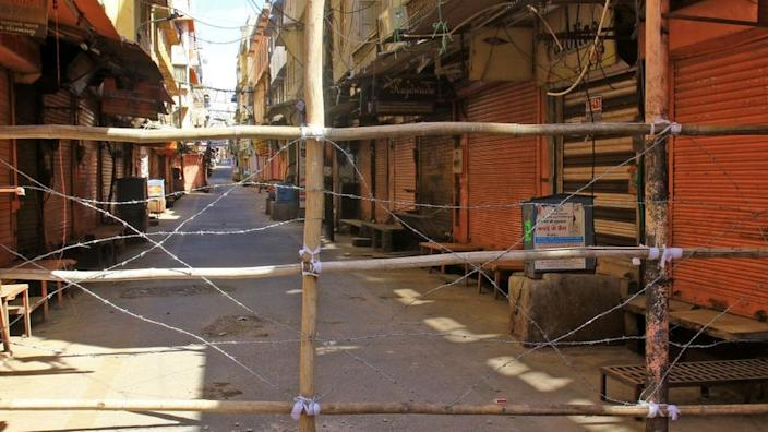 Police blocked lane with wires to restrict movement at sensitive zone of COVID-19