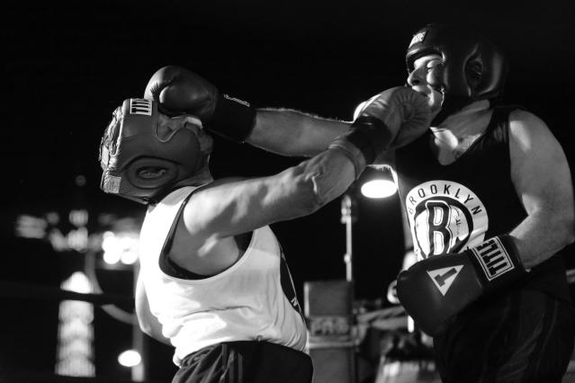 Ruben Duque, left, and Chris Vincenti exchange punches during a grudge match at the Brooklyn Smoker in the parking lot of Gargiulo's Italian Restaurant in Coney Island, Brooklyn, on Aug. 24, 2017. (Photo: Gordon Donovan/Yahoo News)