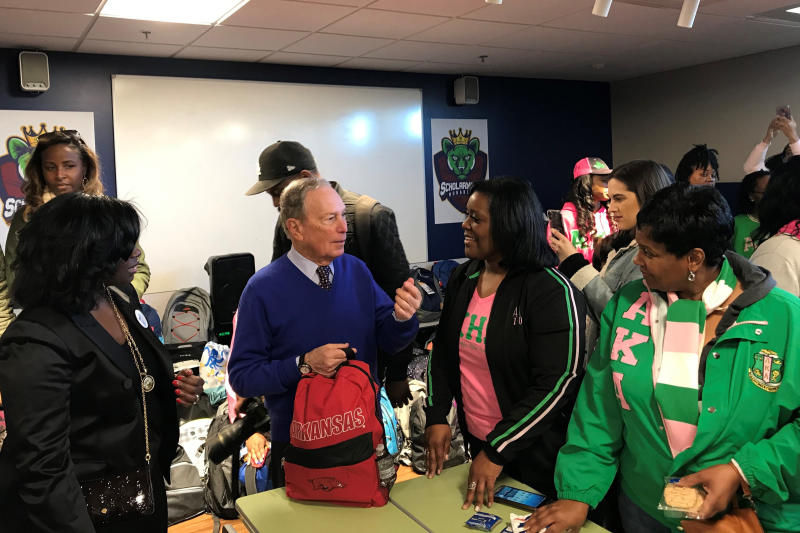 In this Jan. 20, 2020, photo, former New York City Mayor and presidential candidate Michael Bloomberg talks to volunteers assembling backpacks at Scholarmade Achievement Place in Little Rock, Ark. (AP Photo/Andrew DeMillo)