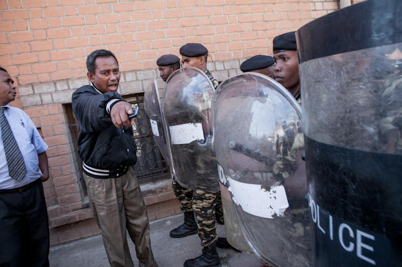 Anti-riot police block the street leading to exiled Madagascar President Marc Ravalomanana's home in Antananarivo, on October 13, 2014 (AFP Photo/Rijasolo)