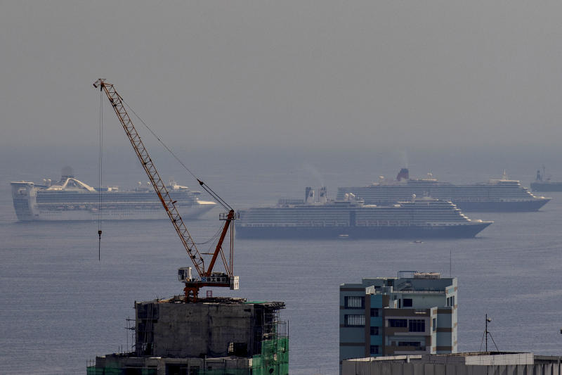 FILE PHOTO: Cruise ships sit idle in the waters of Manila Bay as their crew completes quarantine before being allowed to disembark, on May 29, 2020 in Manila, Philippines. (Photo: Ezra Acayan/Getty Images)
