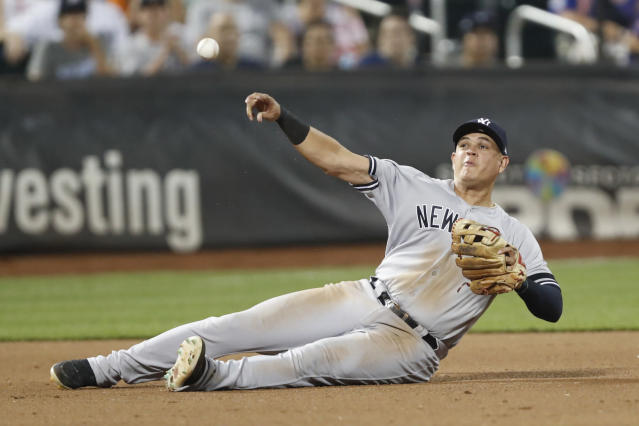 New York Yankees third baseman Gio Urshela throws from the dirt for the out after fielding a grounder by New York Mets' Jeff McNeil during the eighth inning of a baseball game Wednesday, July 3, 2019, in New York. (AP Photo/Kathy Willens)