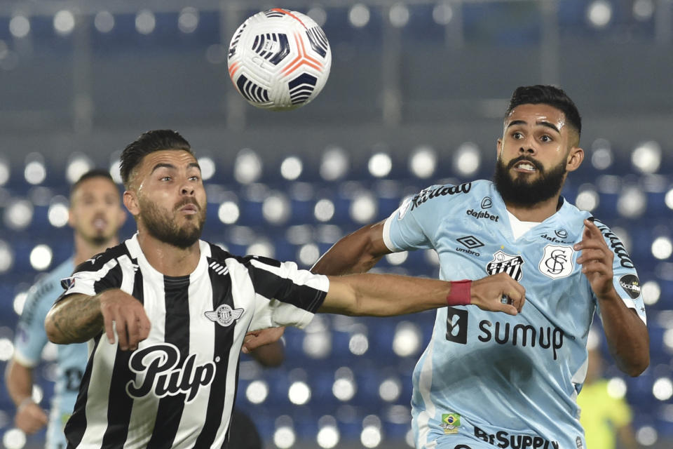 Paraguay's Libertad Hector Villalba (L) and Brazil's Santos Felipe Jonatan vie for the ball during their Copa Sudamericana quarter-finals second leg football match at Defensores del Chaco stadium in Asuncion, on August 19, 2021. (Photo by NORBERTO DUARTE / POOL / AFP) (Photo by NORBERTO DUARTE/POOL/AFP via Getty Images)