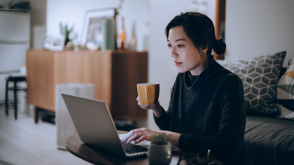 Australians have been reminded to move regularly and eat healthily while working from home. (Image: Getty).