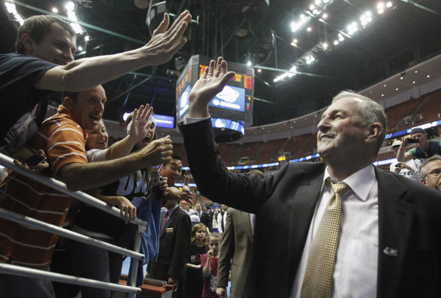 Connecticut Huskies head coach Jim Calhoun greets fans after his team defeated the Arizona Wildcats during their NCAA West Regional college basketball game in Anaheim, California March 26, 2011. REUTERS/Alex Gallardo (UNITED STATES - Tags: SPORT BASKETBALL)