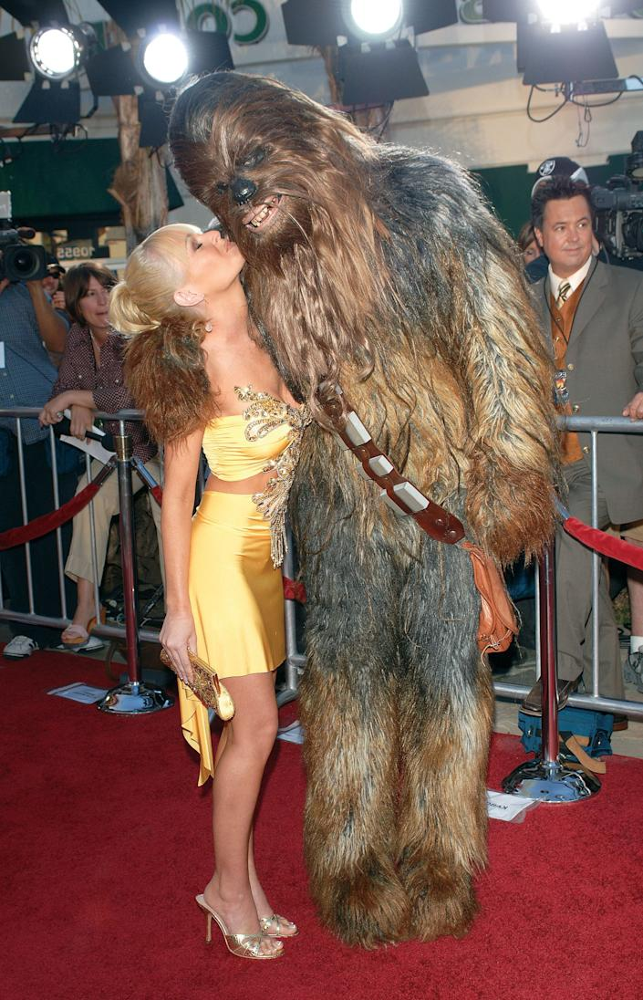 Actress Katie Lohmann arrives at the premiere of 'Star Wars: Episode III: Revenge of the Sith,' a benefit for the charity Artists for a New South Africa and the comprehensive, ground-breaking program for South African children orphaned by HIV/AIDS, held at the Mann Village Theatre. This image appears on page 398 in Frank Trapper's RED CARPET book. (Photo by Frank Trapper/Corbis via Getty Images)