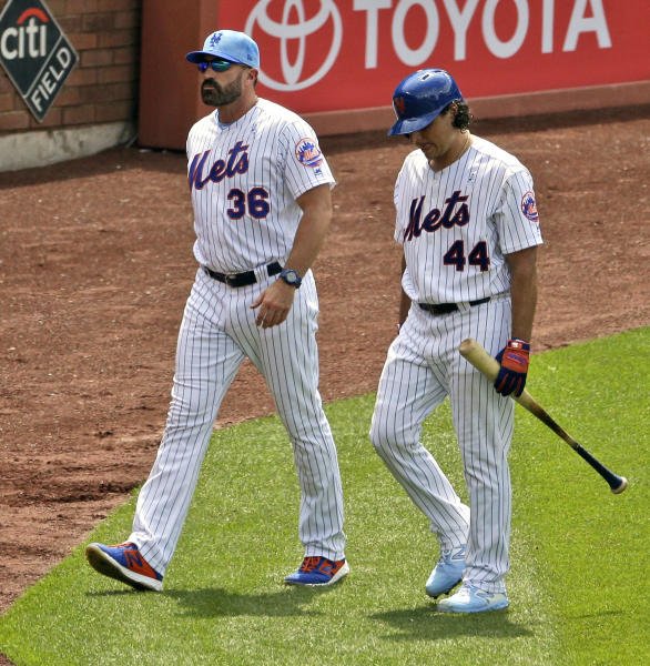 New York Mets' Jason Vargas, right, is accompanied by manager Mickey Callaway as he leaves a baseball game during the fourth inning against the St. Louis Cardinals at Citi Field, Sunday, June 16, 2019, in New York. (AP Photo/Seth Wenig)