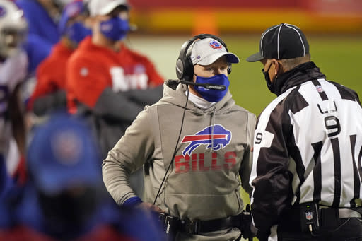 Buffalo Bills head coach Sean McDermott talks with line judge Mark Perlman, right, during the first half of the AFC championship NFL football game against the Kansas City Chiefs, Sunday, Jan. 24, 2021, in Kansas City, Mo. (AP Photo/Charlie Riedel)