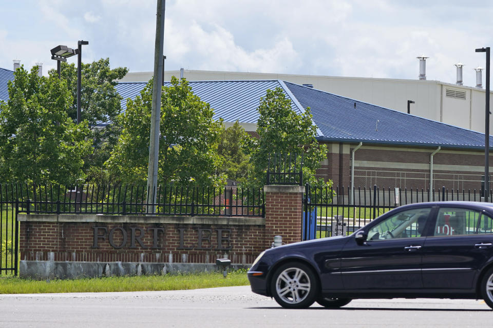 A car drives past one of the entrances of the U.S. Army base Fort Lee Tuesday, Aug. 17, 2021, in Petersburg, Va. Afghan refugees who have been prescreened by the U.S. Department of Homeland Security have been taken to Fort Lee and other temporary reception centers are being set up at Fort Bliss in Texas and Fort McCoy in western Wisconsin. (AP Photo/Steve Helber)