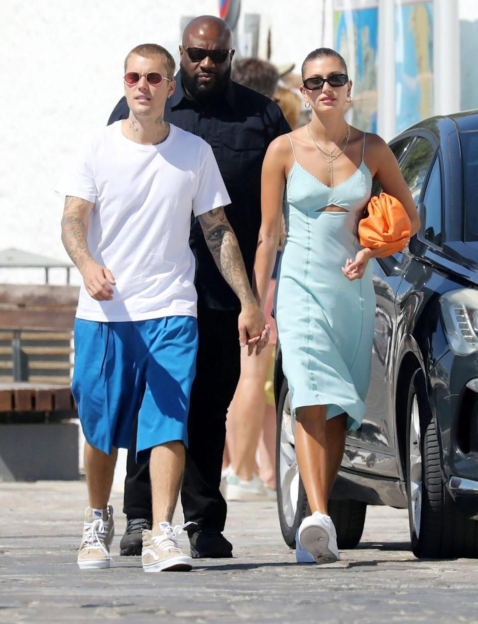 <p>Justin and Hailey Bieber hold hands while out in Mykonos, Greece on June 29.</p>