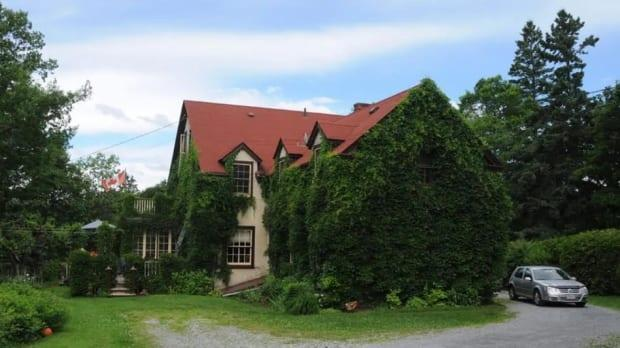 Dennis Oland highlighted the home's English ivy and wisteria vines as among some of its best features in a Facebook post in January when it was listed for sale.