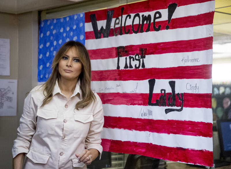 In this June 21, 2018 photo, First lady Melania Trump pauses after signing an artwork of an American flag while visiting the Upbring New Hope Children Center run by the Lutheran Social Services of the South in McAllen, Texas. Melania Trump has made another secret trip, though this one was carried out a little closer to home. The first lady is visiting service members at Walter Reed National Military Medical Center who were injured during combat. She traveled to the Washington-area hospital on Tuesday for a visit that was not publicly announced until after she arrived. (AP Photo/Andrew Harnik)