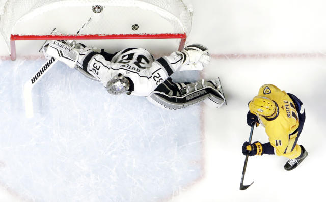 Nashville Predators center Brian Boyle (11) watches as a shot by teammate Kyle Turris gets past Los Angeles Kings goaltender Jonathan Quick (32) for a goal during the first period of an NHL hockey game Thursday, Feb. 21, 2019, in Nashville, Tenn. (AP Photo/Mark Humphrey)