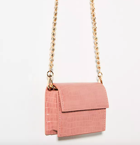 Mini Envelope Crossbody Bag in pink with gold chain strap. Image via Anthropologie.