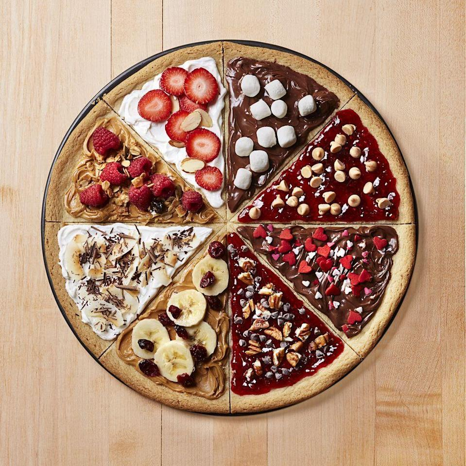 """<p>The most fun way to spend Friday night with the fam! Bake one giant sugar cookie, cut it into 8 wedges, and let everyone decorate their piece with an array of toppings and spreads.</p><p><em><a href=""""https://www.goodhousekeeping.com/food-recipes/a12590/cookie-pizza-recipe-ghk0215/"""" rel=""""nofollow noopener"""" target=""""_blank"""" data-ylk=""""slk:Get the recipe for Cookie &quot;Pizza&quot; »"""" class=""""link rapid-noclick-resp"""">Get the recipe for Cookie """"Pizza"""" »</a></em></p>"""