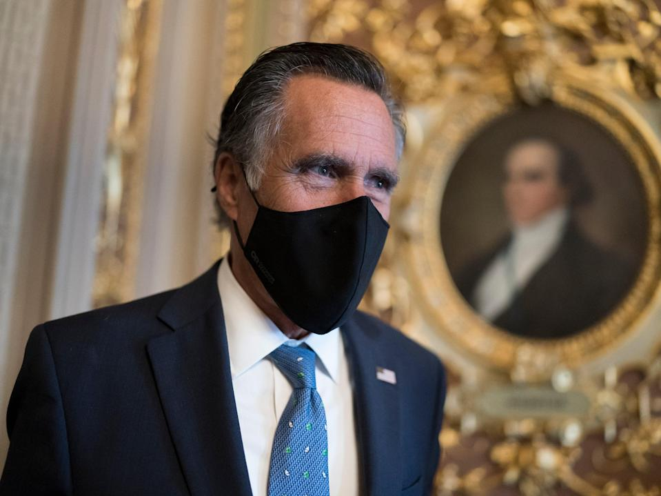 Mitt Romney, R-Utah, pauses to answer questions from reporters as senators arrive to vote on President Joe Biden's nominee for United Nation's ambassador, Linda Thomas-Greenfield, at the Capitol in Washington, on Tuesday 23 February 2021 ((Associated Press))