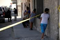 Relatives react near a crime scene where unknown assailants murdered a member of the LGBT community, in Ciudad Juarez